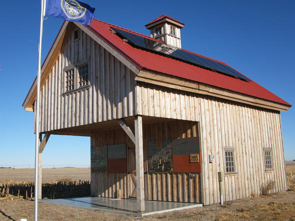 "Pipeline opponents built the ""Energy Barn,"" with its solar panels and windmill, in 2013. They constructed the barn as a symbol of renewable energy — right on the pipeline's proposed route."