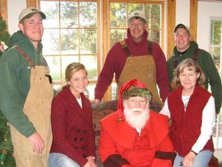 The Carroll family has turned the holiday season into their family business. The family is pictured here with Santa, who visits their Christmas tree farm on weekends in December.