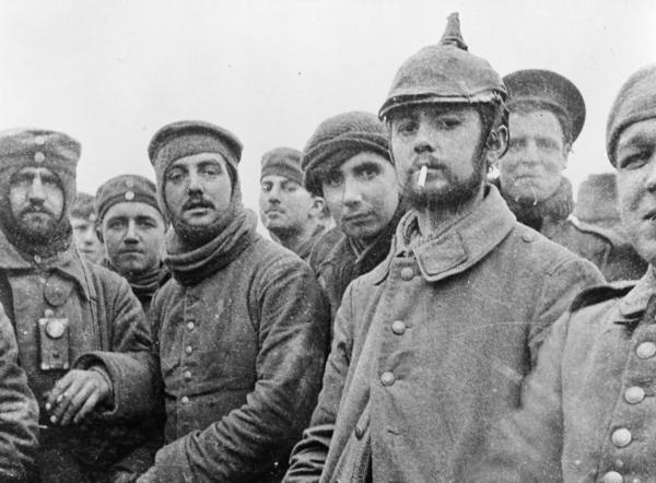 British and German soldiers fraternizing at Ploegsteert, Belgium, on Christmas Day 1914. World War I was raging at the time, but front-line troops initiated the truce, which they documented in photos and letters. Commanders on both sides were furious when they learned of it.