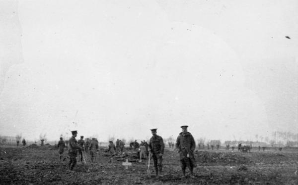"The 1914 Christmas truce was an opportunity for both sides to bury their dead. Alan Wakefield of the Imperial War Museum, describes the photo: ""Four British soldiers in the foreground (are) beside a grave, a recently dug grave. And a mixed group of German and British in the background, actually digging fresh graves for other casualties."""