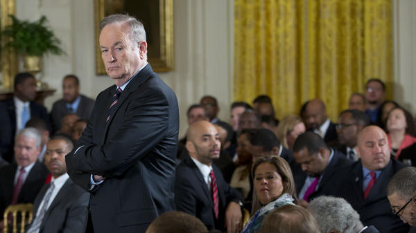 Television personality Bill O'Reilly waits for the start of an event at the White House in February 2014. O'Reilly has for the past week fired back angrily at critics who have accused him of inflating his war-reporting record in a manner similar to suspended <em>NBC Nightly News</em> anchor Brian Williams.