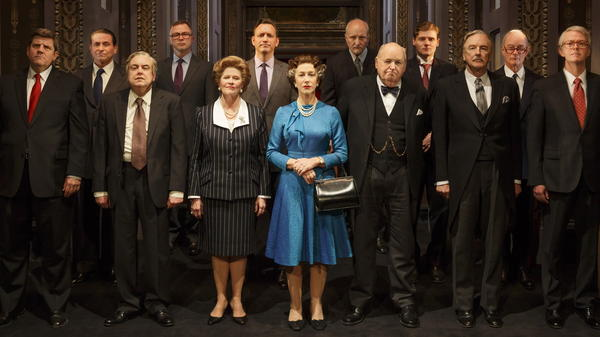 Helen Mirren (in blue) plays Queen Elizabeth II in <em>The Audience</em>, a play that imagines the private conversations between the queen and her prime ministers.