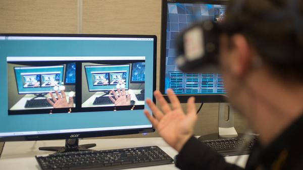 MindMaze Software Engineer Nicolas Bourdaud demonstrates a virtual reality system at the Game Developers Conference in San Francisco on Tuesday.
