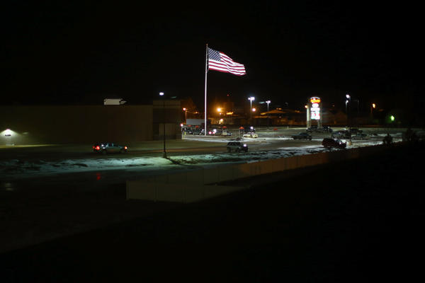 The American flag waves above the parking lot of the new strip mall in Sidney.