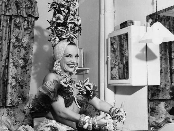 During her lifetime, singer and dancer Carmen Miranda (shown here in a dressing room at the London Palladium in 1948) was a huge success in the United States, but rejected at home in Brazil as a sellout.
