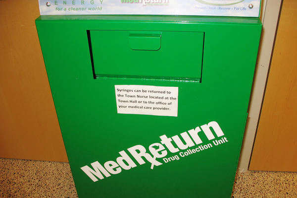 Used needles are deposited in sharps containers like this one at the police station.