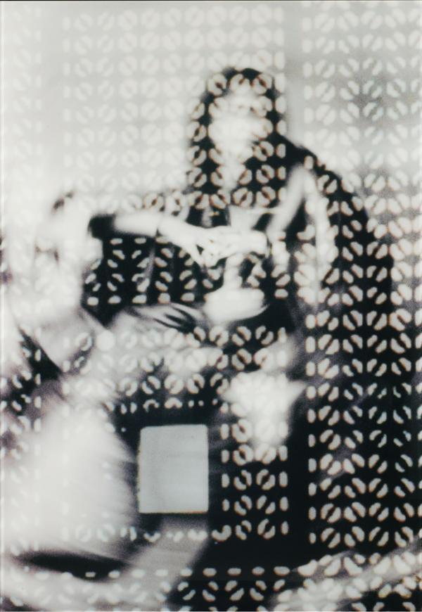 "Curator Linda Komaroff says the woman in Susan Hefuna's <em>Woman Behind Mashrabiya I</em> is ""very mysterious — and deliberately so."""