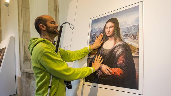 "A blind visitor to Spain's Prado Museum runs his fingers across a 3-D copy of the <em>Mona Lisa</em>, painted by an <a href=""http://www.npr.org/2012/02/02/146288063/painting-sheds-new-light-on-the-mona-lisa"">apprentice</a><a href=""http://www.theguardian.com/artanddesign/2012/feb/01/new-mona-lisa-prado""> </a>to Leonardo da Vinci."