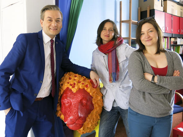 Slupsk Mayor Robert Biedron (from left) and LGBT activists Marta Abramowicz and Marta Kosinska stand next to a symbolic Gdansk lion statue painted in rainbow colors in honor of the city's first gay rights march, held in May.