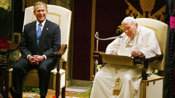 President George W. Bush listens as Pope John Paul II reads a statement at the Vatican in 2004.