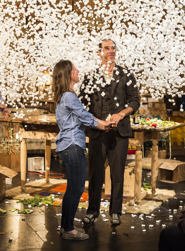 """After a dinner date, complete with ice skate tap dancing, Geoff Sobelle and his audience member """"date"""" gets showered with packing peanuts."""