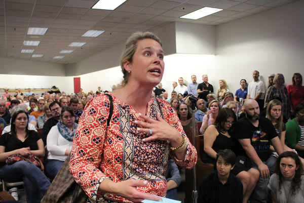 Mother-of-three Cole Kelley expresses her concerns about the landfills at a community meeting in October. Kelley lives in the St. Louis suburb of Ladue, about 9 miles away from Bridgeton, where the landfills are located. She was one of about 500 area residents who attended the meeting.