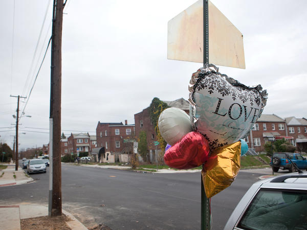 A memorial is seen on West Baltimore street at the site of the city's 300th homicide this year, Wednesday, Nov. 19, 2015 in Baltimore, MD.