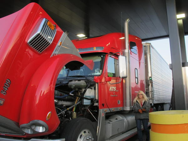Drivers fill up at the Petro truck stop in Oak Grove, Mo. Because most drivers are paid by the mile, delays at stops eat directly into their earnings.