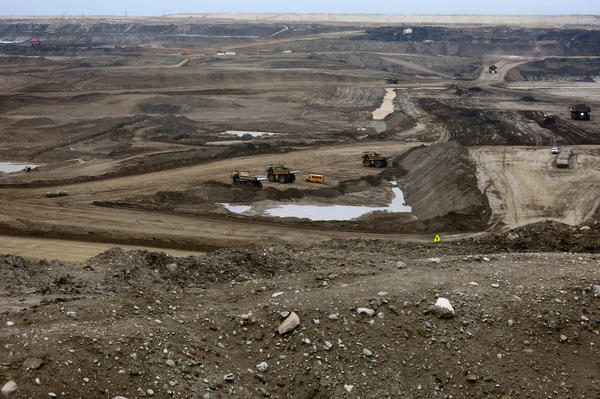"""Shell's Jack Pine Mine near Fort MacKay, Alberta. The largest trucks, called """"heavy haulers,"""" can hold 400 tons of oil sands material. It takes 2 tons to produce one barrel of oil."""