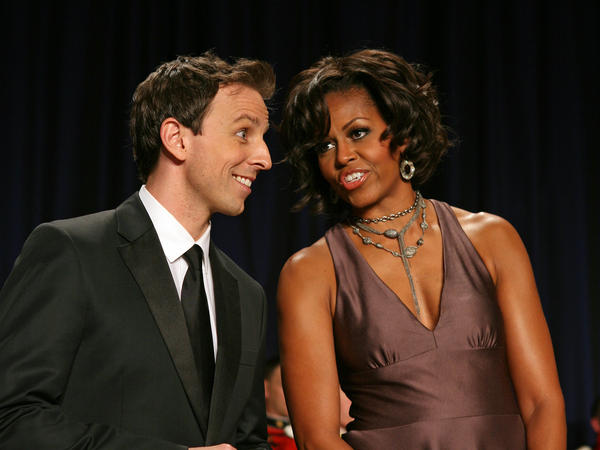 First lady Michelle Obama chats with Seth Meyers at the start of the 2011 White House Correspondent's Association Gala.