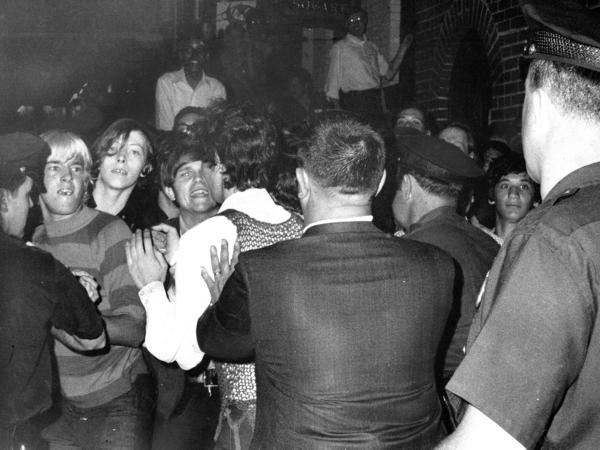 A crowd attempts to impede police arrests outside the Stonewall Inn in New York City on June 28, 1969.