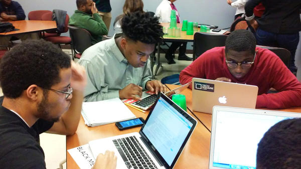 Morehouse College freshmen Philip Rucker, Damon Redding and Tyree Stevenson use a programming language called Python to plot a map of weather stations in the United States.