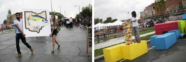 People walk around the Independents' Day Festival in the Franklinton neighborhood. Columbus' economy is boosted by its relatively central location in the state, being the capital, and being the home of Ohio State University.