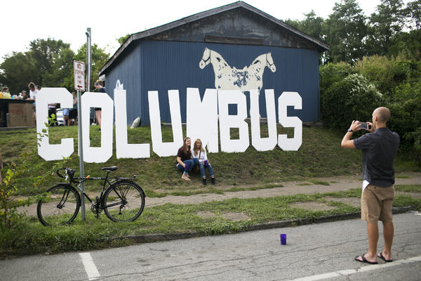 People attend the Independents' Day Festival in the Franklinton neighborhood of Columbus, Ohio. The city has become a nearly recession-proof hub.