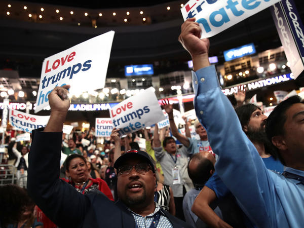 """Delegates at the Democratic National Convention in Philadelphia in July hold up signs that read """"Love trumps hate."""""""
