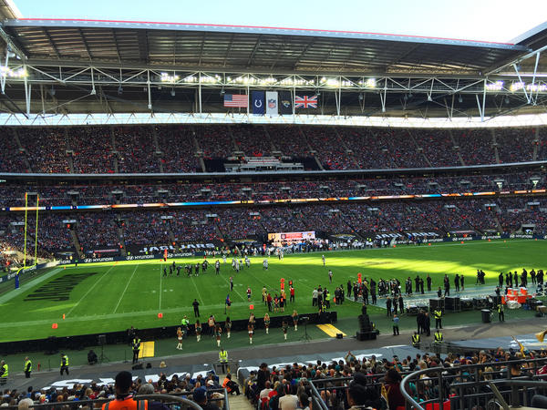 Thousands of fans wearing jerseys representing all 32 NFL teams attend opening day of the NFL's International Series at London's Wembley Stadium on Sunday.