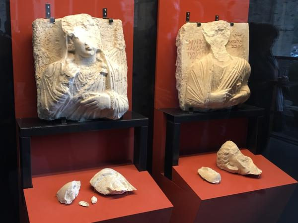 Two ancient marble busts, damaged during ISIS's occupation of the ancient site of Palmyra in Syria, are included in the exhibition.