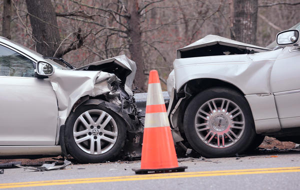 Officials investigate a fatal head-on collision on Route 1 at the town line of Wiscasset and Woolwich in Maine in May.