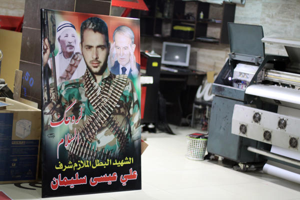 The print shop run by Lammah Jadeed used to make posters for cafes, but now mostly prints signs commemorating men who have died fighting for Assad.