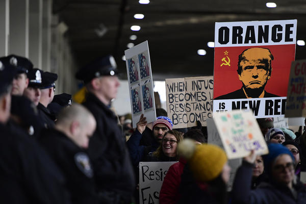 Demonstrators gather Sunday at Philadelphia International Airport to protest President Trump's travel ban on refugees and citizens of seven Muslim-majority nations.