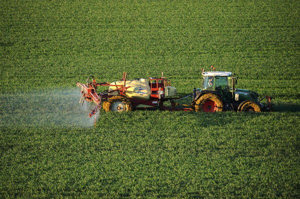 A farmer sprays a chemical fertilizer containing nitrogen on a wheat field in southern France. Nitrogen fertilizers are a known source of greenhouse gases and water pollution all over the world.