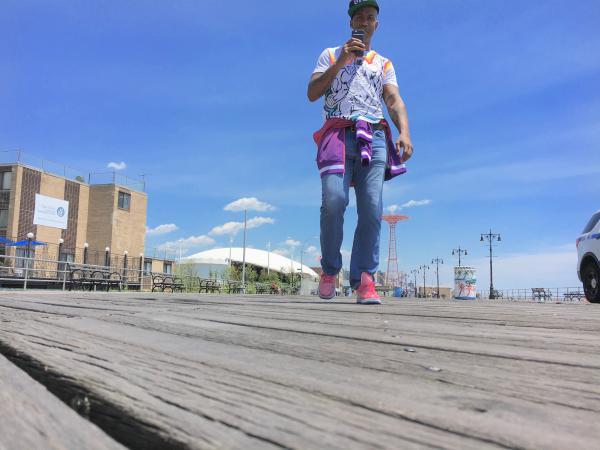 Stephon Marbury wears a pair of his Starbury sneakers on the Coney Island boardwalk.