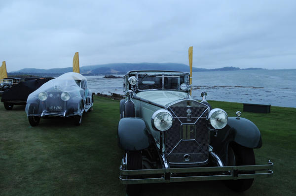 Before sunrise, a 1928 Isotta Fraschini Tipo 8A S Castagna Landaulet on the Pebble Beach Golf Links' 18th green for judging. The car is owned by Peter and Jennifer Gleeson of Edmonds, Wash. Pebble Beach Concours d'Elegance is where hundreds of the wealthiest car collectors buy, sell and show off their cars.