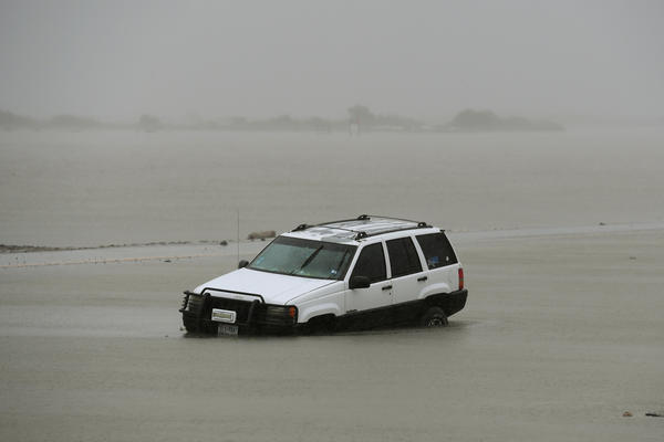 A car is partially submerged after Harvey hit Corpus Christi.