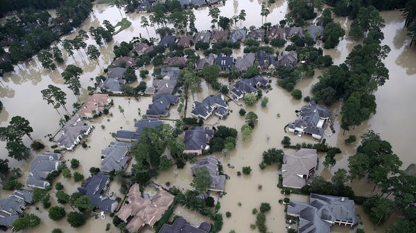 Homes near Lake Houston were almost completely under water on Wednesday. Based on the experiences of past storm victims, returning home could take years.