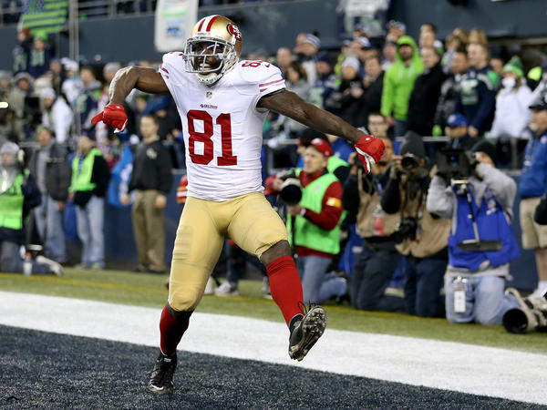 Former San Francisco 49ers wide receiver Anquan Boldin celebrates scoring a touchdown during the 2014 NFC Championship.