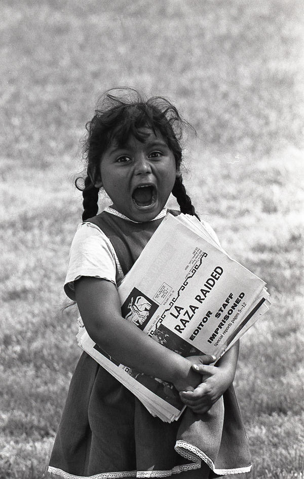 <em>A young Chicanita hawks </em>La Raza<em> newspapers at the Poor People's Campaign, Washington, D.C.</em> May–July 1968.