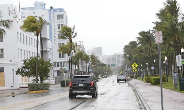 Ocean Drive in Miami Beach, Fla., sits empty Saturday morning as the outer bands of Hurricane Irma begin to lash the state.