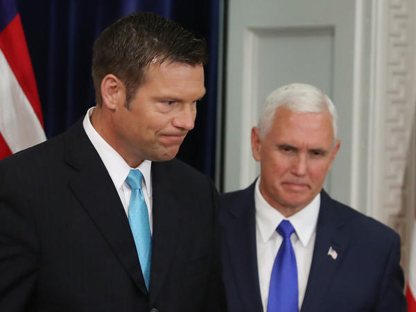 Kansas Secretary of State, Kris Kobach, left, and Vice President Pence at the first meeting of the Presidential Advisory Commission on Election Integrity, in July.