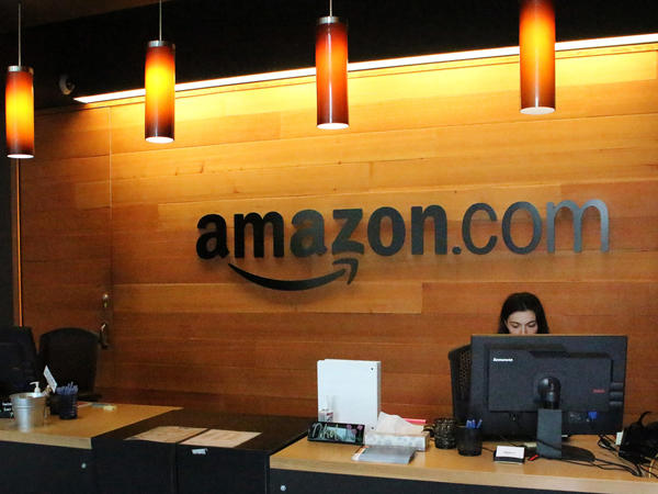 "Nikol Szymul staffs a reception desk at Amazon offices in downtown Seattle. Online retail powerhouse Amazon is searching for a second headquarters location, which an official from Toronto has called ""the Olympics of the corporate world."""