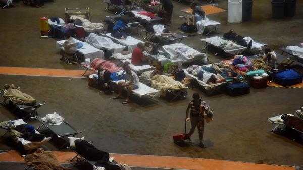Residents seek shelter inside Roberto Clemente Coliseum in San Juan, Puerto Rico, early on Wednesday, as Hurricane Maria struck the island.