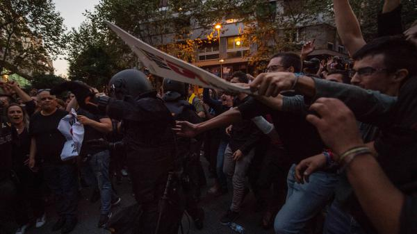 Demonstrators clash with Spanish National Police officers outside the headquarters of a pro-independence political party in Barcelona, Spain, on Wednesday.