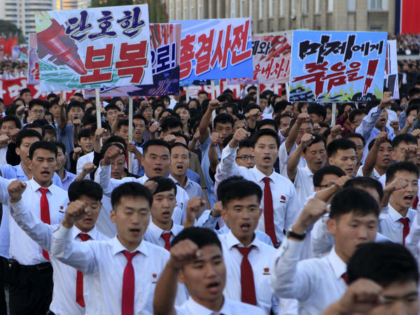 North Koreans gather at Kim Il Sung Square to attend a mass rally against America on Saturday in Pyongyang.