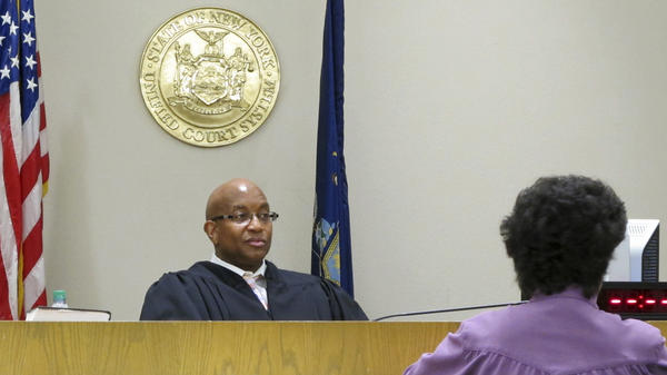 In this June 20 photo, City Court Judge Craig Hannah presides at Opiate Crisis Intervention Court in Buffalo, N.Y. The first such program in the country puts users under faster, stricter supervision than ordinary drug courts, all with the goal of keeping them alive.
