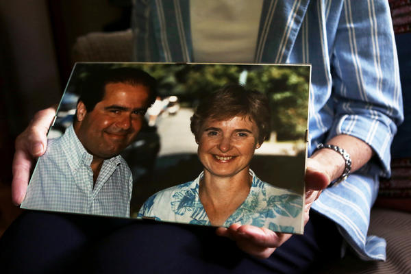 Maureen Scalia holds one of her favorite photos of her and her husband, the late Supreme Court Justice Antonin Scalia, in their home in Virginia.