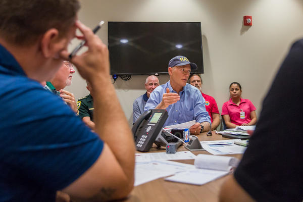 Gov. Rick Scott meets with officials in Marathon, Fla. on Sept. 22, 2017.