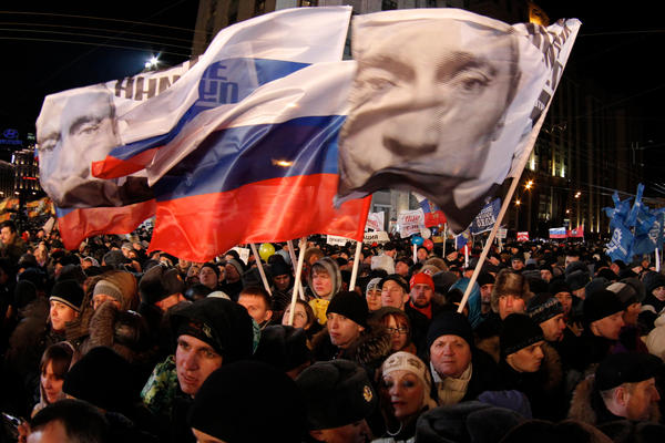 Supporters of Russian Prime Minister Vladimir Putin rally at Manezh square outside Kremlin, in Moscow, Russia, Sunday, March 4, 2012.  (Ivan Sekretarev/AP)