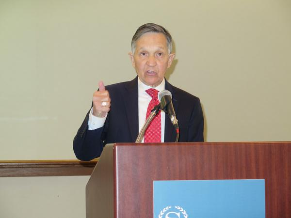 Dennis Kucinich makes a point to reporters