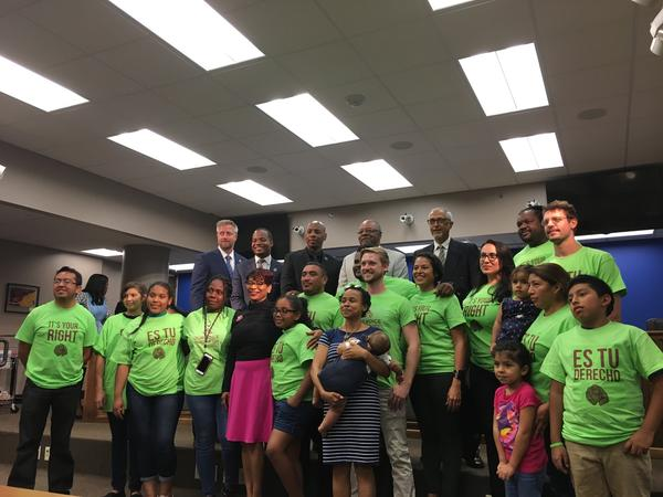 Members of Nuestra Voz posed for a photo with school board members and OPSB superintendent Henderson Lewis after the board passed policies meant to buffer students from immigration and law enforcement.