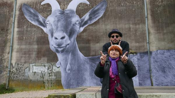 Agnès Varda (front) and JR (back) journey through France, creating art and cultivating community in <em>Faces Places</em>.